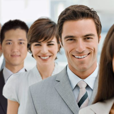 Closeup portrait of happy business group standing together in office